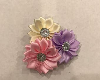 Three flowers with rhinestone center