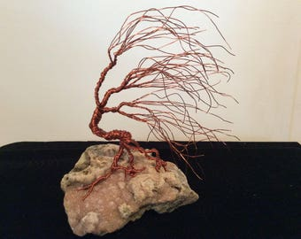 Wind swept wire sculpture tree