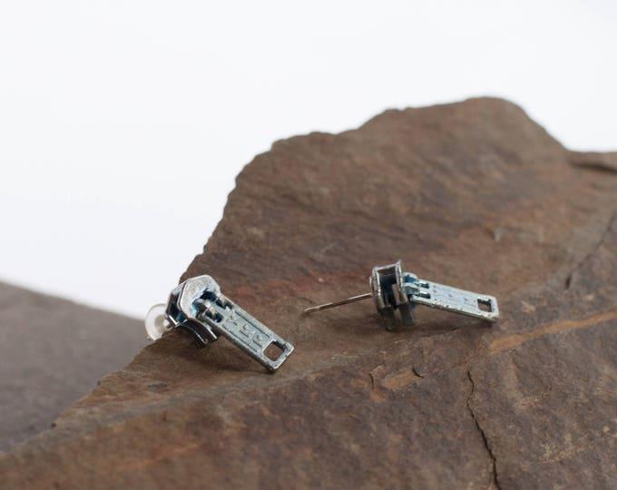 Earrings made from reclaimed zippers sliders