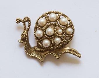 Vintage pearl snail brooch