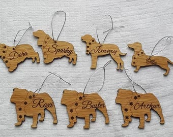 Wooden personalised dog Christmas tree decorations.