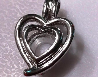 Double heart pearl cage pendant