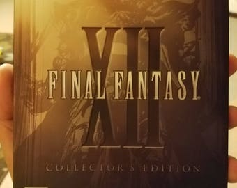 FINAL FANTASY 12. FF12. clean and tested. complete with metal collector's case and manual and bonus disc. Playstation 2 game