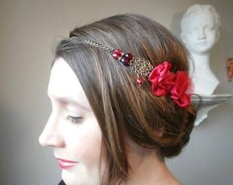 Headband flowers red silky chiffon-style Gatsby, early twenties, retro vintage.