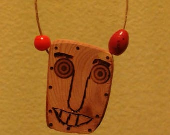 Hand made, one of a kind, charming face wood burned on cedar