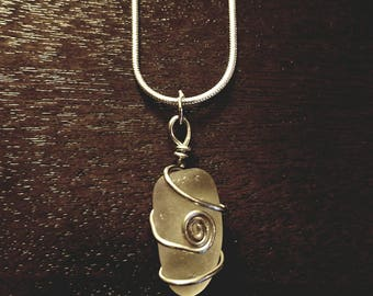 Natural beach glass necklace. Found on A lake Erie beach wrapped with silver wire into this beautiful authentic design
