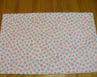 Pretty in pastel floral and solid color flannel and fleece blanket
