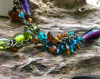 Gorgeous vintage glass pendant necklace filled with glass beads!