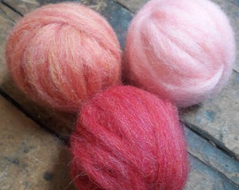 wool roving in shades of pink for felting, spinning, weaving 1.5 oz