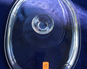 40. Oval glass lid 9  5/8 x 7  1/2