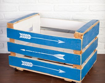 Fruit box restored and painted in blue and white with arrows