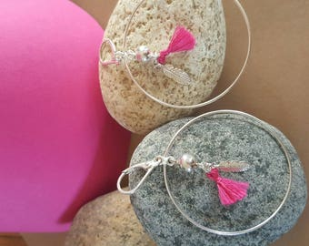 big hoops earrings feathers and tassels