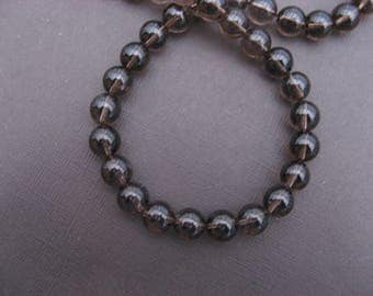 Smoky quartz: 5 round beads 10 mm.