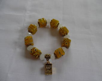 Bracelet cube millefiorie yellow and white and his box of crayons charm.