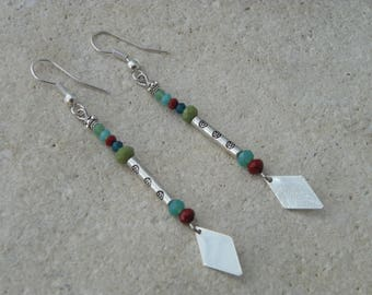 Long earrings and silver triangle