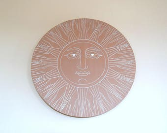 Painting representing the Sun engraved and hand painted wooden