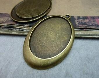 40*30mm; 2 supports en bronze pour cabochons de 40*30mm