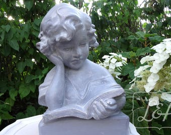 Bust of girl reading weathered gray and linen