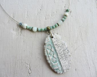 Oval Pendant Necklace ceramic raku and ethnic inscriptions, semi-precious jade stone, soft ivory and green hues