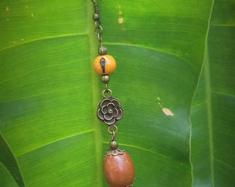 Dende seeds and acai on bronze earrings