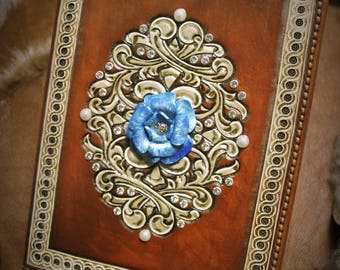 stunning carved leather book for wedding memories