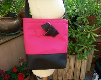 by Mary j creations synthetic leather bag. Fuchsia and black with a pretty bow at the front, very feminine. Size