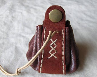 Coin purse is burgundy red leather