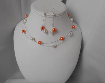 ELA ornament with orange and Pearl Necklace and Pearl Earrings