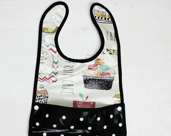 Bib oilcloth with pattern balaines system
