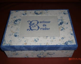 Hand-made rectangular box cardboard lid decorated with embroidery on linen