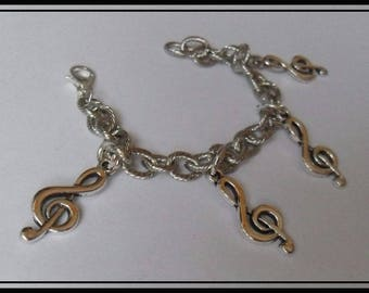 Silver plated bracelet chain with musical note pendants