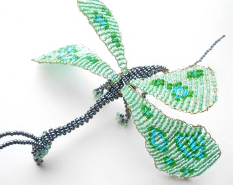 Dragon Butterfly in black and green seed beads.
