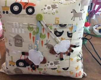 Farmyard Animals Cushion with a Pocket.