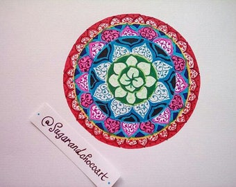 Round mandala design made in bright colors with markers