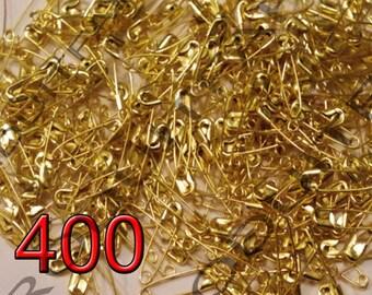 Lot of 400 Mini pins of nurses in Metal Golden 19 x 5 mm.