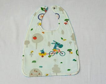 Bib patterned baby bike ride