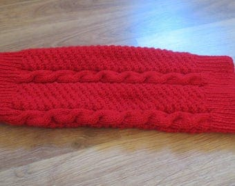 Hand knitted red color sleeve.