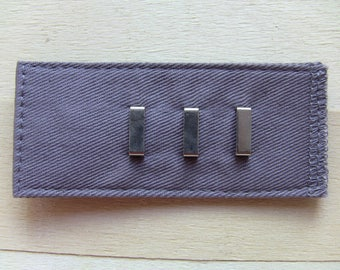extension clasp hook for dark gray pants or skirt adjustable to 3 positions