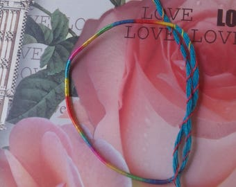 "Friendship Bracelet brings good luck lucky charm bracelet turquoise blue and multicolored cord ""love"""