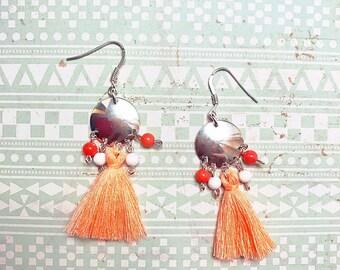 Earrings in silver and orange tassel