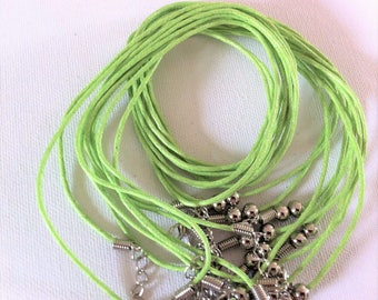 2 necklaces made of cotton cord lime with clasps and extension chains