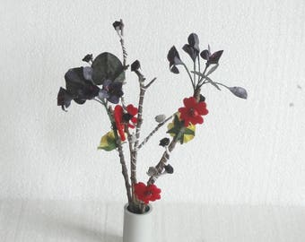 Bouquet paper flowers and tree branches