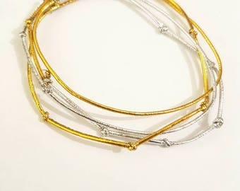 Elastic cord bracelet. Silver and gold.