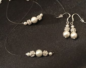 Adornment jewelry white pearls / Rhinestones, necklace, bracelet, earrings, nylon thread, silver plated.