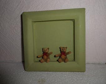 olive green frame with two brown bears