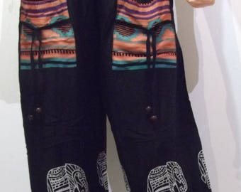 Large, black and colorful flowing pants with elephants