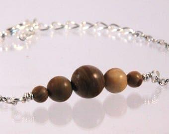 Bracelet 5 beads of wood lace stone.