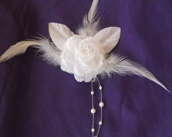 Back train, brooch or boutonniere white color