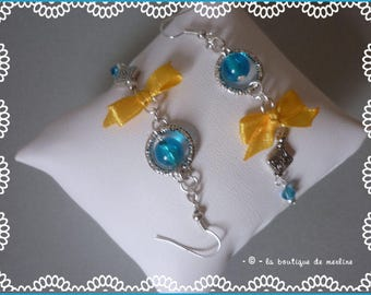 Costume jewelry: beads and small yellow satin bow dangle earrings