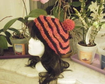 Warm hat with multi colored, solid black and heathered wool flame